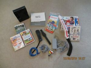 Wii black console with games