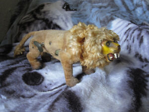 Antique animated wind up lion toy