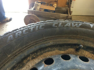 4 Artic Claw snow tires and rims