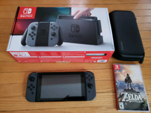 Nintento Switch Console + Breath of the Wild and Carrying Case