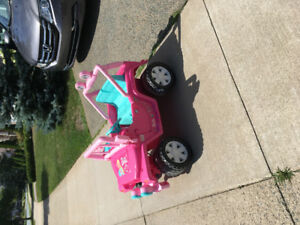 Ride in Barbie car .. great condition.. rechargeable battery.