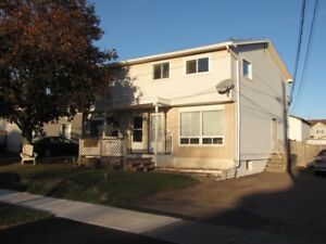 Side By Side Duplex , fully Rented  Central Moncton