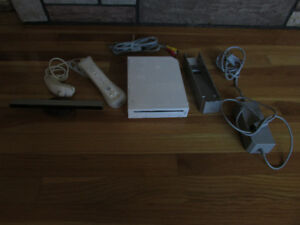 Nintendo Wii System, games, gun, wheels, etc.