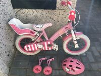 Hello kitty bike with stabilisers and helmet £25 lot