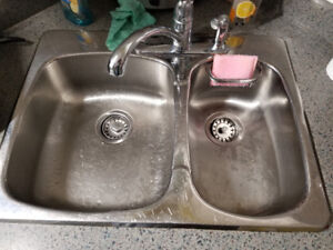 Stainless steel sink and a half with moan tap