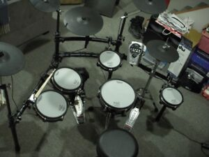 Roland TD-15 Electric drums with lots of expensive extras.