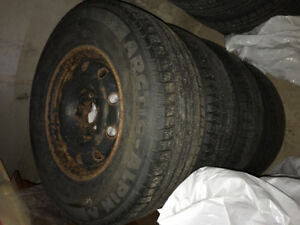 Michelin Arctic Alpin P225/75R15 winter tires on rims