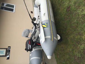 12 ft. Zodiac for sale and 2.5 Suzuki motor