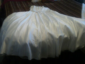 Beautiful white strapless satin wedding gown