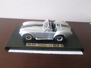 1964 Shelby Cobra in box, Norman Rockwell in Frame Inuit