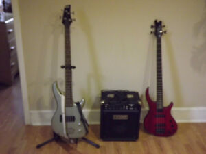 2 electric base guitars