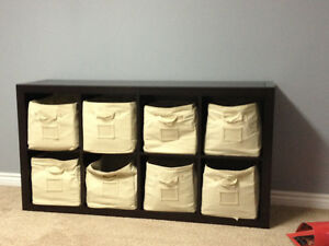 Shelving unit with bins