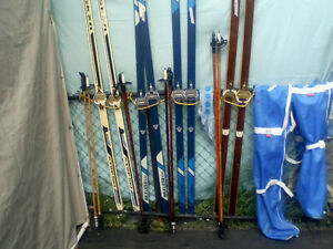 4 pairs X-country skis and poles $10.00/set