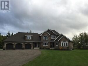 Magnificent custom built home nestled in 1.68 acre lot!!