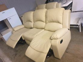 A like new cream leather effect 3 x 2 reclining sofas.
