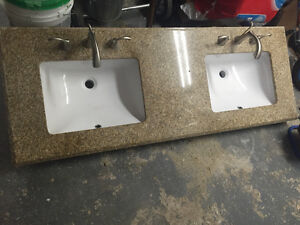 Double sink granite countertop with working faucets