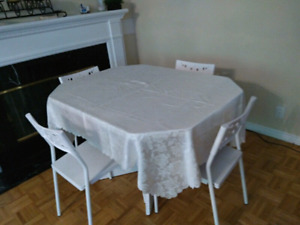 White dining table and 4 white chairs