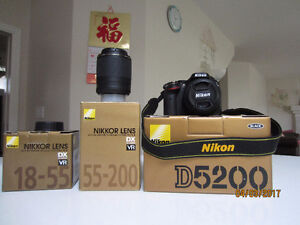 Nikon D5200 with two zoom lenses