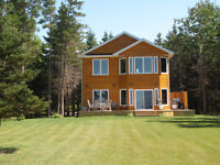Oceanfront cottage, sleeps 10, central location on the Island