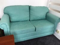 Immaculate two seater sofa bed.