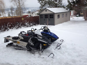 Snowmobiles and trailer