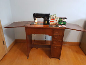 Singer Sewing Machine and table and accessories