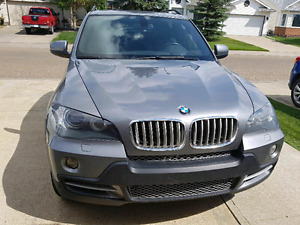looking for 2008 or 2009 bmw x5 please contact