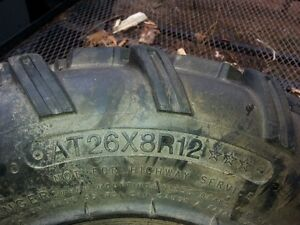 two used  atv  tires