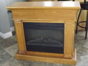 Electric fireplace with mantel for sale