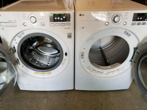 White Lg stackable washer and dryer