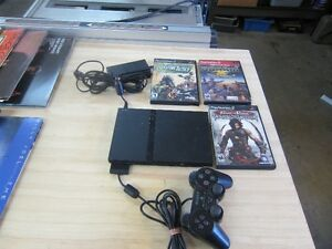 PS 2 CONSOLE AND THREE GAMES, 2 CONTROLLOR's