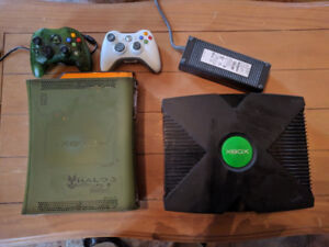 I have an Xbox original (black), Controller and lots of Games...