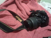 Nikon D3000 with 18-55mm lense