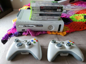 Xbox 360 with games and controllers