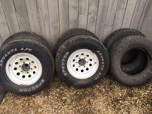 "4x 15x6.5"" rims, 6x 235-75r15 tires"