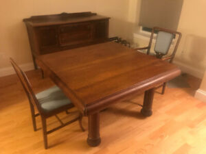 Antique oak dining table, 2 chairs, and buffet