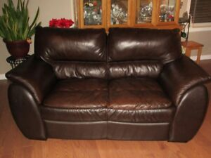 Brown leather loveseats