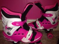 New Pink Rollerskates size 3-5