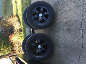 4   16 inch rims and tires 225/70r/16 will fit 2005 Toyota