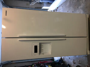 White Samsung side-by-side fridge with ice maker