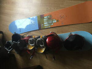 Snowboards one pair bindings two helmets and two pair boots.
