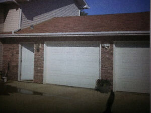 Two 9' garage doors for sale