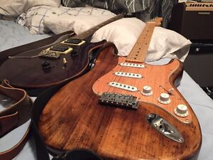Strat style guitar natural stain finish