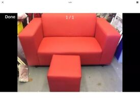 Modern red faux leather sofa & matching stool