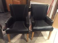 2 Leather effect carvar dining room chairs