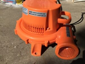 Air blower for air filled inflatable slides, pools, and castles