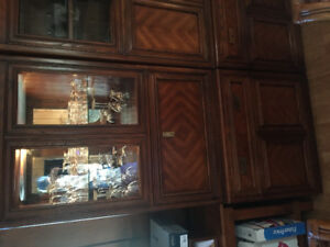 Bar cabinet with lighted glass top