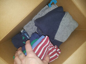 Coffee box of Boys 12 month Carters and Size 3 diapers
