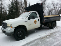 2003 Ford F-450, with a 2012 12' new dumpbox