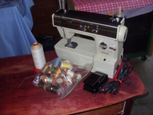 Sewing machine like new with accessories